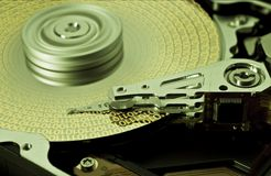 Hard disk drive with yellow data. Open hard disk drive with yellow data in close up Royalty Free Stock Image