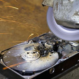 Hard disk driveand angle grinder Royalty Free Stock Image