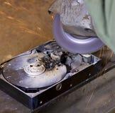 Hard disk driveand angle grinder Stock Image