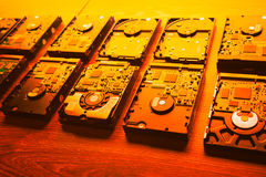 Hard disk drives in a rows, orange tone Stock Images