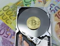 Hard disk with golden bitcoin and background currency of europe Stock Photography