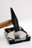 Hard disk and a hammer. Removing data from hard disk - conceptual photo Royalty Free Stock Photos