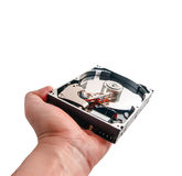 Hard disk in hand isolated on a white Royalty Free Stock Image