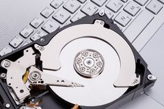 Hard disk HDD over laptop keyboard Stock Photography
