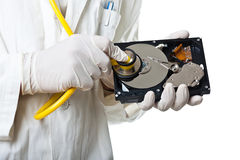 Hard Disk Healthcare detail. A Doctor/Technician wearing a lab coat and stethoscope holding an hard disk Royalty Free Stock Photo