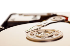 Hard disk isolated. Close-up inside view of hard disk isolated on white background Royalty Free Stock Image