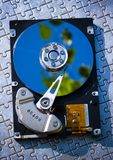 Hard disk on jigsaw Stock Photos