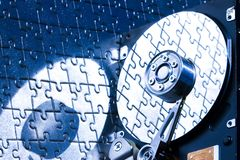 Hard disk on jigsaw. Hard disk is the brain of computer Royalty Free Stock Photos