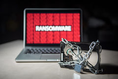 Hard disk locked with monitor show ransomware cyber attack Stock Photo