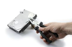 Hard disk locked under attack by one hand Stock Photos