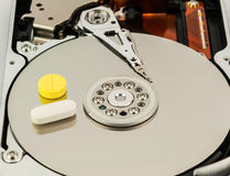Hard disk with medicine Stock Photo