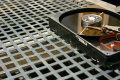 Hard disk on a metal grid. Open hard disk on a metal grid Royalty Free Stock Images