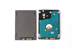 Hard disk next to ssd disk solid state drive blue technological Royalty Free Stock Photos