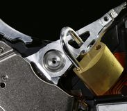 Hard disk with an open padlock as a concept for computer data se. Hard disk of a computer with an open padlock as a concept for computer data security stock image