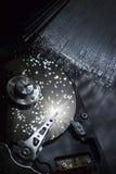 Hard disk with optical fibers. An opened hard disk drive with optical fibers Royalty Free Stock Photos