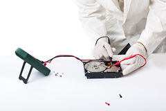 Hard disk recovery. A technician repairing an hard disk with a tester Stock Photo