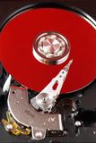 Hard disk and red plate. Rotation Royalty Free Stock Photos