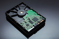 Hard Disk on a reflective background stock image