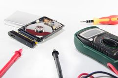 Hard disk repairing. A broken hard disk with repairing and diagnostic tools Royalty Free Stock Image