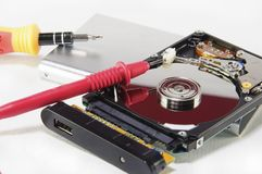 Hard disk repairing. A broken hard disk with repairing and diagnostic tools Stock Photography