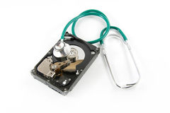 Hard disk with a sthetoscope Stock Photography