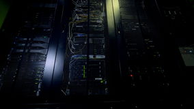 Blinking lights of data storage towers working all day long. Hard disk and switches glow behind the doors showing their performance status stock footage