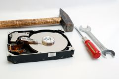 Hard disk and tools. Hard disk and a few tools - reparation Royalty Free Stock Images