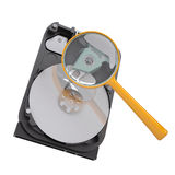 Hard disk under a magnifying glass. Isolated render on a white background Royalty Free Stock Image