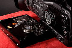 Hard disk and video camera Royalty Free Stock Image