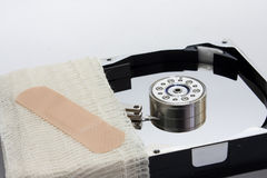 Hard disk wrapped in a bandage Stock Photography