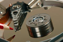 Hard disk, writing pencil, writing to the disc royalty free stock images