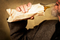 Hard drinker. With a bottle in the paper bag Royalty Free Stock Photo
