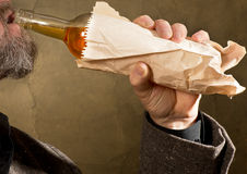 Hard drinker. With a bottle in the paper bag Stock Images