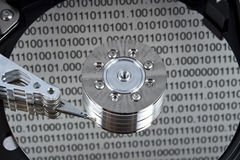 Hard drive. Binary data reflection on an open hard drive disks Royalty Free Stock Image