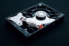 Hard drive assembly uncovered, arm head and platters stock photos