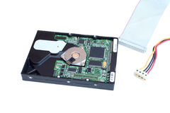 Hard Drive with cables. Open hard drive casing with power lead and IDE ribbon cable showing connectors Stock Photo