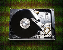 The hard drive from the computer in the background  of the matri. The hard drive from the computer in the background of the digits of the matrix Stock Photos