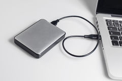Hard drive connected to the computer Royalty Free Stock Photo