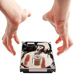 Hard drive details and hands Royalty Free Stock Images