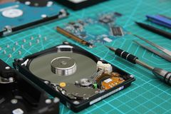 Repair of the HDD disassembled on a working surface of green color royalty free stock photo