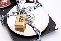 Hard drive disk and combination lock padlock. Stock Photo