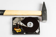 Hard drive disk and hammer repair Stock Photography