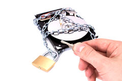 Hard drive disk and padlock. Royalty Free Stock Photography