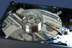 Hard drive and dollars Royalty Free Stock Photography