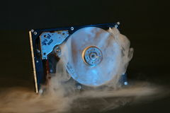 Hard drive failure. A hard drive with smoke coming out of it royalty free stock photography