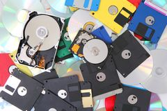 Hard drive, floppy disc, and cd-rom. As data background Stock Photo