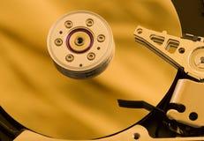 Hard drive gold. Hard drive using golden reflector royalty free stock photo