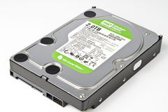 Hard drive with green label Royalty Free Stock Image