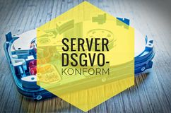 Hard drive 3.5 inches as a data storage with motherboard on a bamboo table and in german server dsgvo-konform in english server gd royalty free stock images