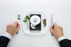 Hard drive is on a plate royalty free stock photos